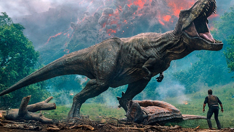 Movie image showing a R. rex and an actor