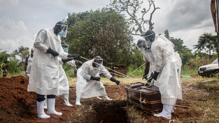 (EDITORS NOTE: Image depicts death) Health workers wearing