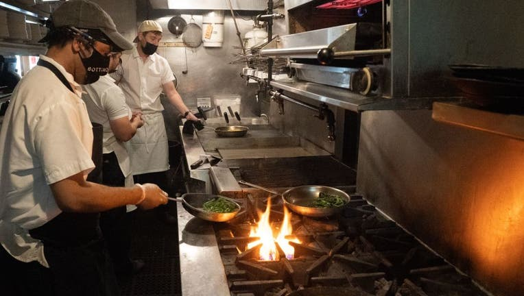 Chefs work at Bottino Restaurant in Chelsea as NYC restaurants open for limited capacity indoor dining.