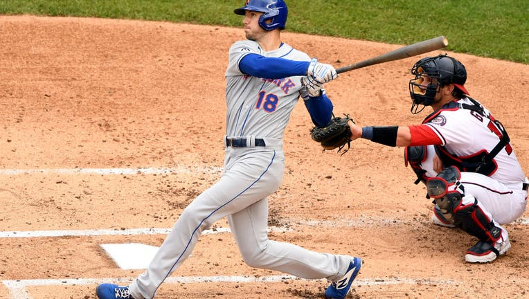 Ryan Cordell #18 of the New York Mets takes a swing during a baseball game against the Washington Nationals at Nationals Park on September 27, 2020 in Washington, DC.
