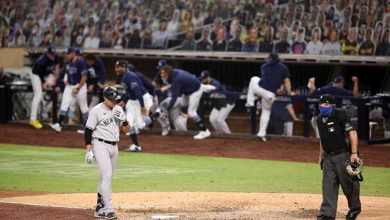 Gio Urshela #29 of the New York Yankees reacts after lining out during the ninth inning
