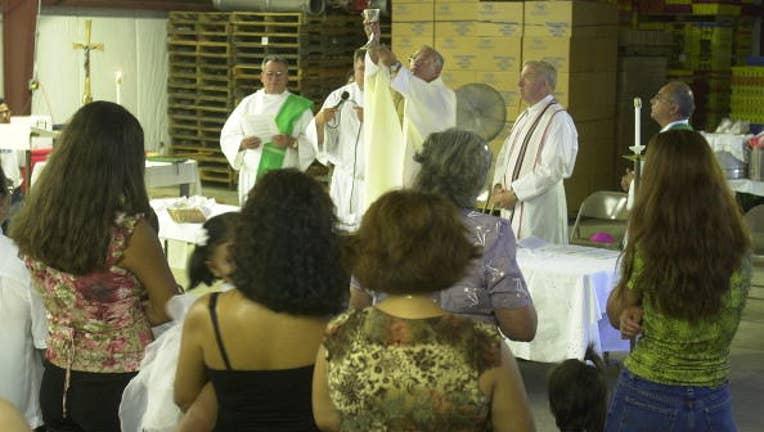 FILE -Catholic Mass in Hammonton, New Jersey.