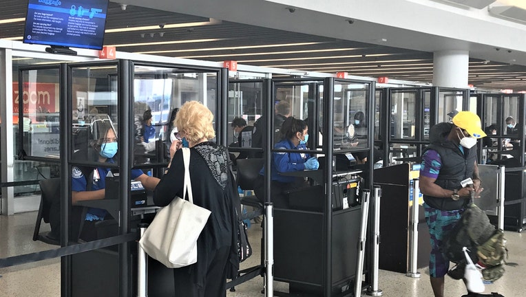 Clear acrylic barriers around several TSA checkpoints