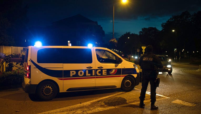 French police officers stand guard a street in Eragny on October 16, 2020, where an attacker was shot dead by policemen after he decapitated a man earlier on the same day. (Photo by ABDULMONAM EASSA/AFP via Getty Images)