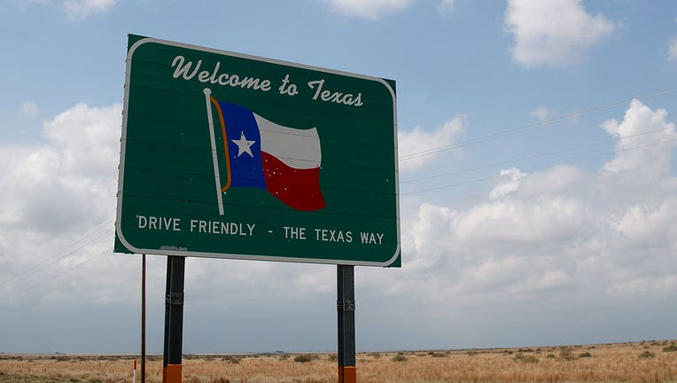 A 'Welcome to Texas' sign stands on the side of the road near Dalhart, Texas.(File Photo by Drew Angerer/Getty Images)