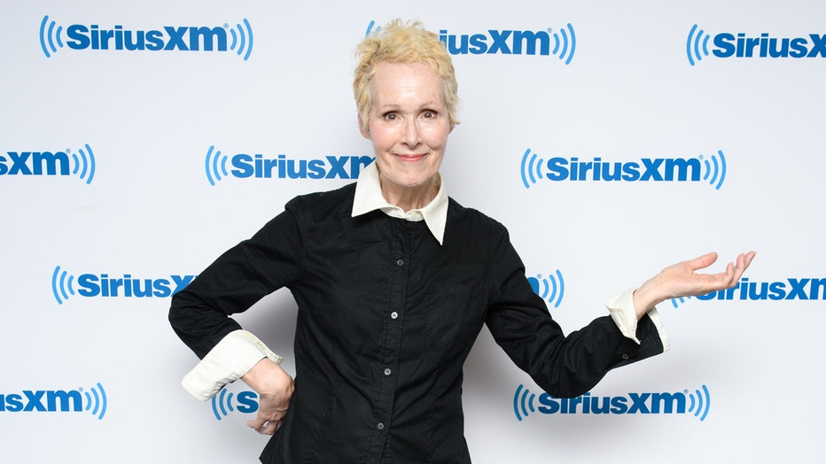 E. Jean Carroll stands in front of a Sirius XM logo wall
