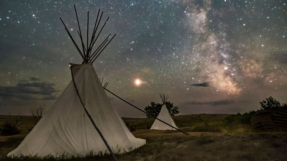 Mars and the Milky Way over the tipis at Two Trees area in Grasslands National Park