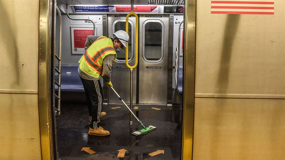 A cleaning crew disinfects a New York City subway train on May 4, 2020 in New York City. (Photo by Stephanie Keith/Getty Images)