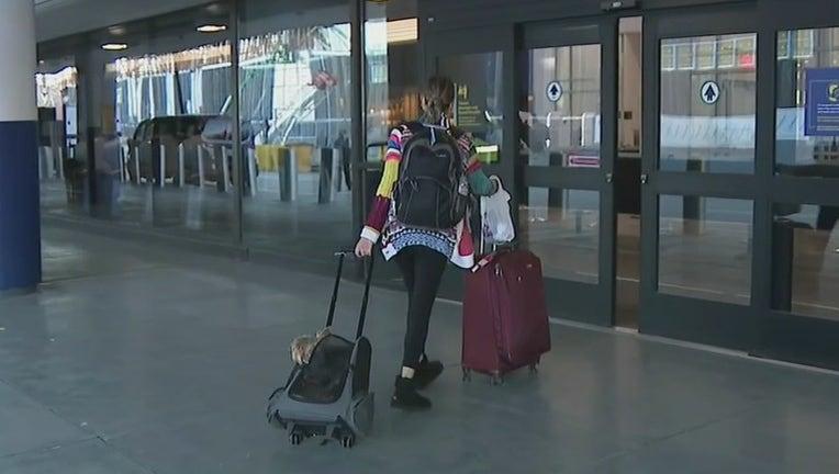 A traveler enters a terminal at LaGuardia Airport