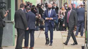 Biden shows off walking boot on his injured foot