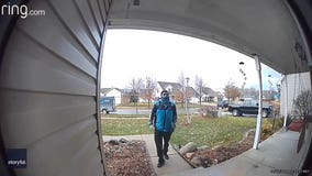 Video captures delivery driver stopping to salute home of Air National Guard member