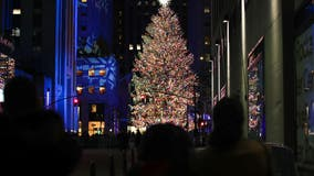 Rockefeller Center Christmas Tree illuminated under pandemic rules