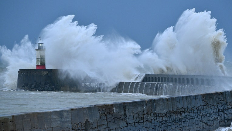 Hurricane-force winds up to 106 mph batter Britain