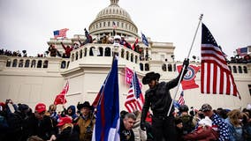 FBI: Accused Capitol rioter tried to flee to Switzerland