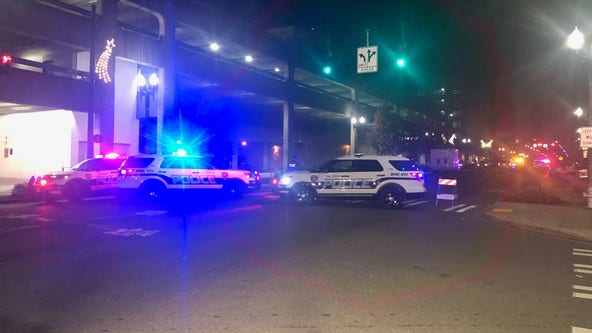 At least 2 people injured after Tacoma police car runs through crowd gathered for street racing