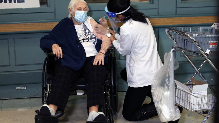 Rhoda Winkelman, a resident at the New Jewish Home in Manhattan, receives the Pfizer-BioNTech COVID-19 vaccine on December 21, 2020 in New York City.