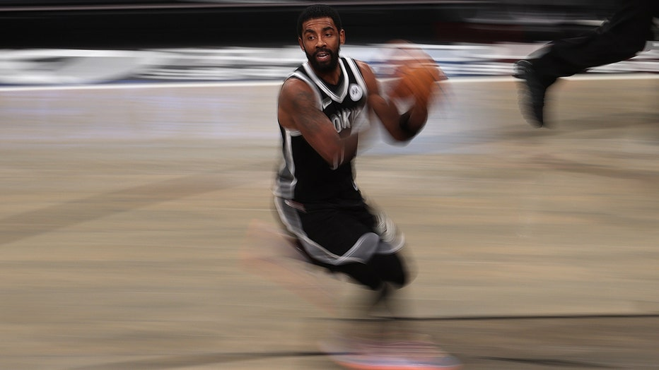 Kyrie Irving of the Brooklyn Nets dribbles