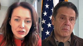Ex-Cuomo aide says governor kissed her, suggested strip poker