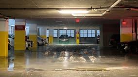 Pipes burst, flood Uptown Dallas apartment parking garage