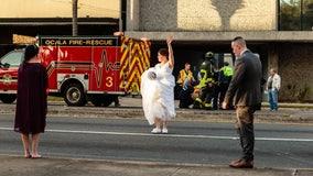 Newlywed Florida deputies pause wedding photos to help man hit by car