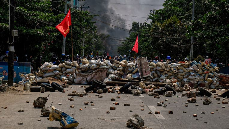 Smoke rises after protesters burn tyres