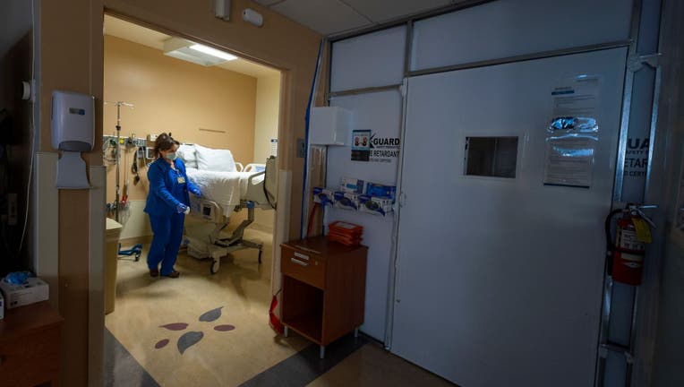 Cathy Cullen, RN cleans a temporary COVID-19 patient
