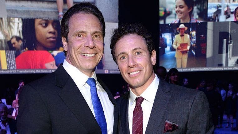 NEW YORK, NY - MAY 12: New York Governor Andrew Cuomo and Chris Cuomo attend The Robin Hood Foundation's 2015 Benefit at Jacob Javitz Center on May 12, 2015 in New York City.