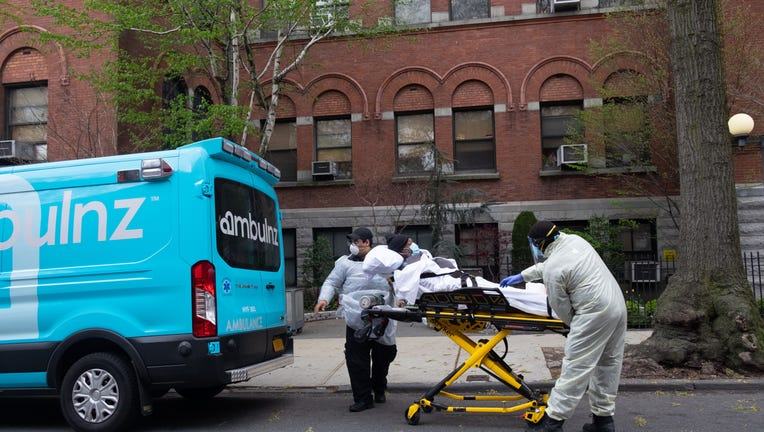 NEW YORK CITY, UNITED STATES - 2020/04/17: Ambulance workers pickup an elderly man from Cobble Hill Health Center, the nursing home that recently registered an alarming amount of covid-19 deaths.