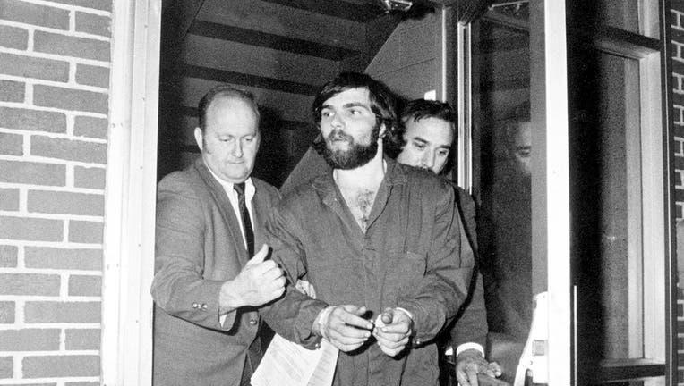 Detectives escort a hancuffed Ronald DeFeo