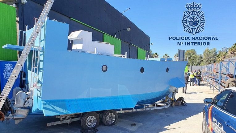In this handout photo from the Spanish National police, a homemade semi submersible submarine sits outside a warehouse in Malaga, Spain. (Police Nacional)
