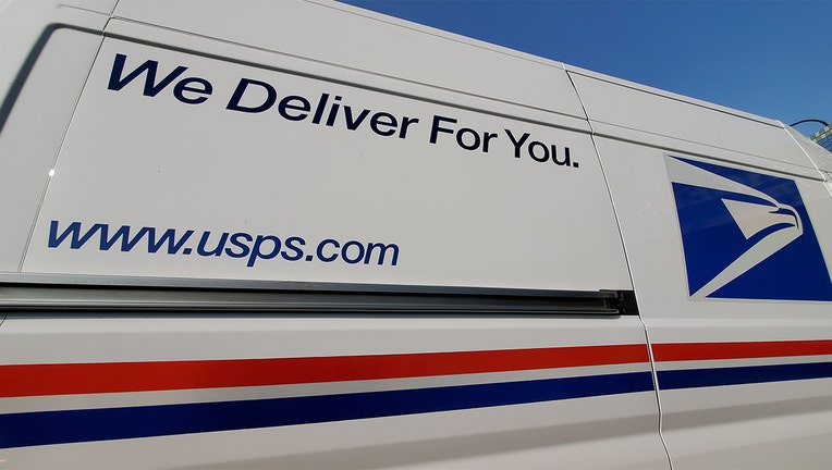 Wide angle view of logo on United States Postal Service (USPS) truck, Lafayette, California, September 17, 2020.