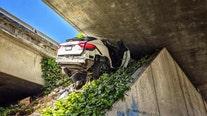 Man fleeing police wedges Maserati under freeway
