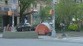 Homeless couple pitches tent on street in Manhattan