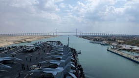 US Navy aircraft carrier passes through Suez Canal after crews free stranded cargo ship