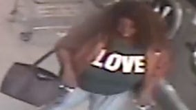 Woman wearing LOVE shirt attacks laundromat worker with bottle of detergent