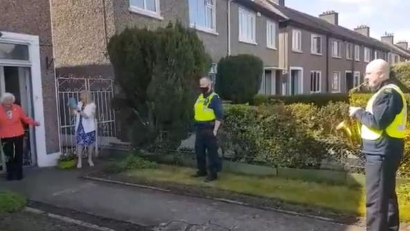 100-year-old woman dances as Irish police serenade her with celebratory saxophone tune