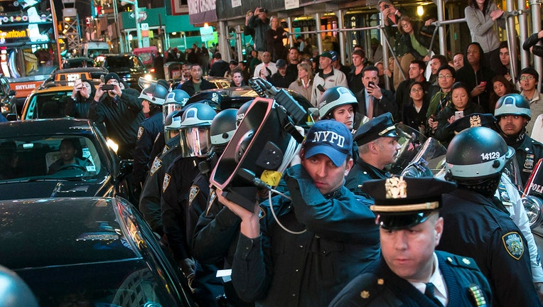 Cop holding a sound cannon amid a protest
