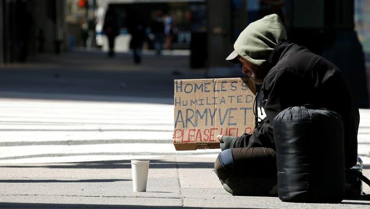 A homeless man begs for money on 42ne Street amid the coronavirus pandemic on April 11, 2020.