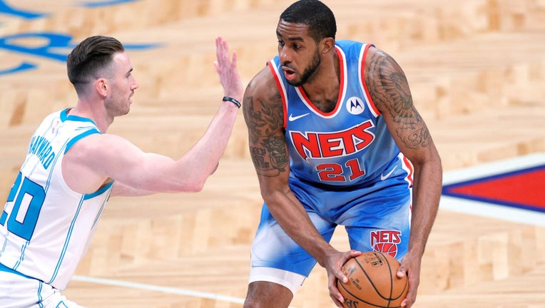 NEW YORK, NEW YORK - APRIL 01: LaMarcus Aldridge #21 of the Brooklyn Nets dribbles against Gordon Hayward #20 of the Charlotte Hornets during the first half at Barclays Center on April 01, 2021 in the Brooklyn borough of New York City.