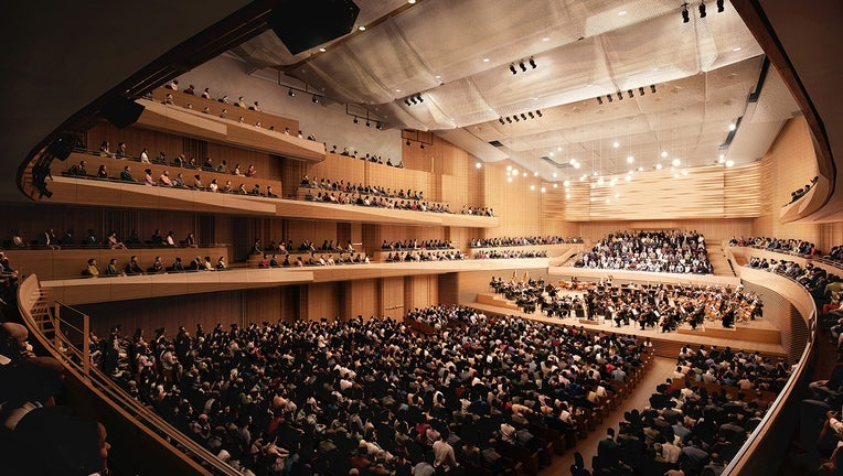 Artist's rendering of interior of a concert hall depicting people sitting in seats watching an orchestra on a stage