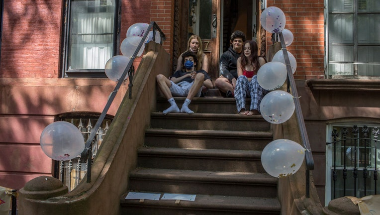 BROOKLYN, NY - MAY 17: A social distancing birthday party is held on the front stoop for two twin teenagers turning eighteen on May 17, 2020 in Brooklyn, New York.