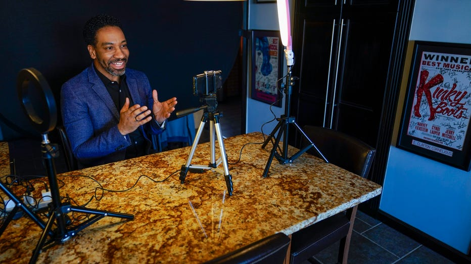 Actor E. Clayton Cornelious poses for a photo in the makeshift studio set up in his home for auditioning, Monday, March 22, 2021, in New York.