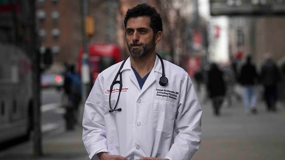 Emergency room Dr. Joseph Habboushe pauses during an interview Friday, Feb. 26, 2021, in New York.