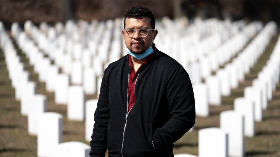 Undertaker Jesus Pujols stands for a portrait at Cypress Hills National Cemetery, Friday, March 12, 2021, in the Brooklyn borough of New York.