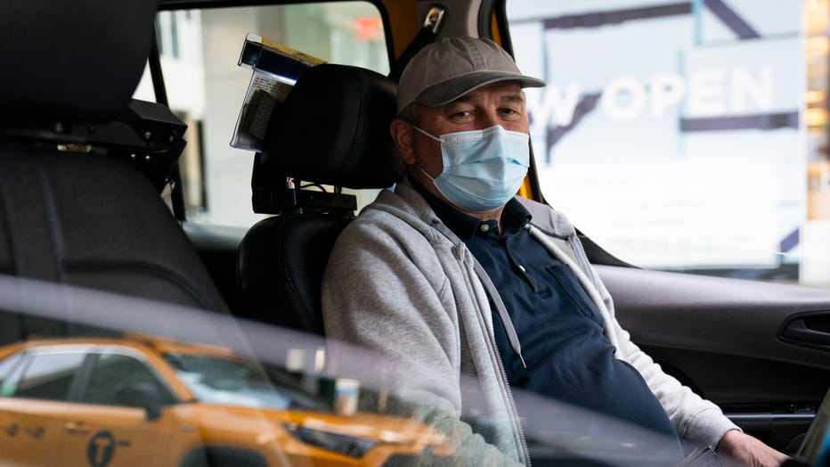 Nicolae Hent sits for a portrait in his taxi outside a midtown Manhattan hotel, in New York on March 19, 2021.