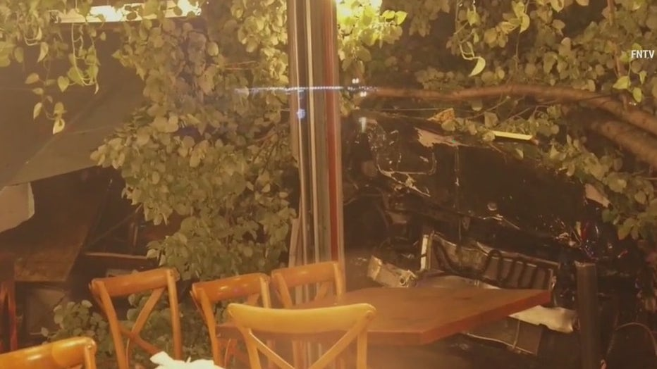 A female pedestrian was struck by debris and injured when a driver plowed into an outdoor dining structure in Astoria.