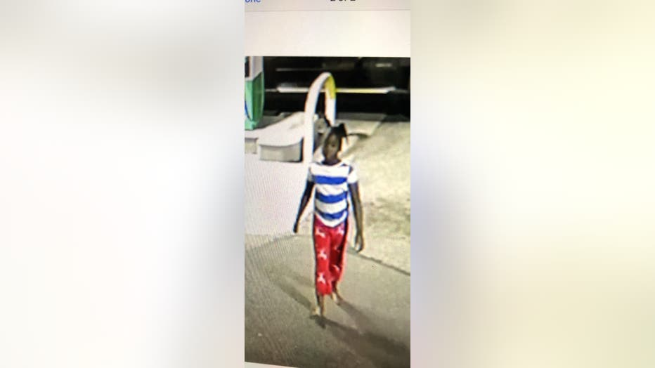Surveillance video of the black girl with a thin build shows her wearingpink pajama pants, a white and blue horizontal striped shirt, large hoop earrings, and no shoes.
