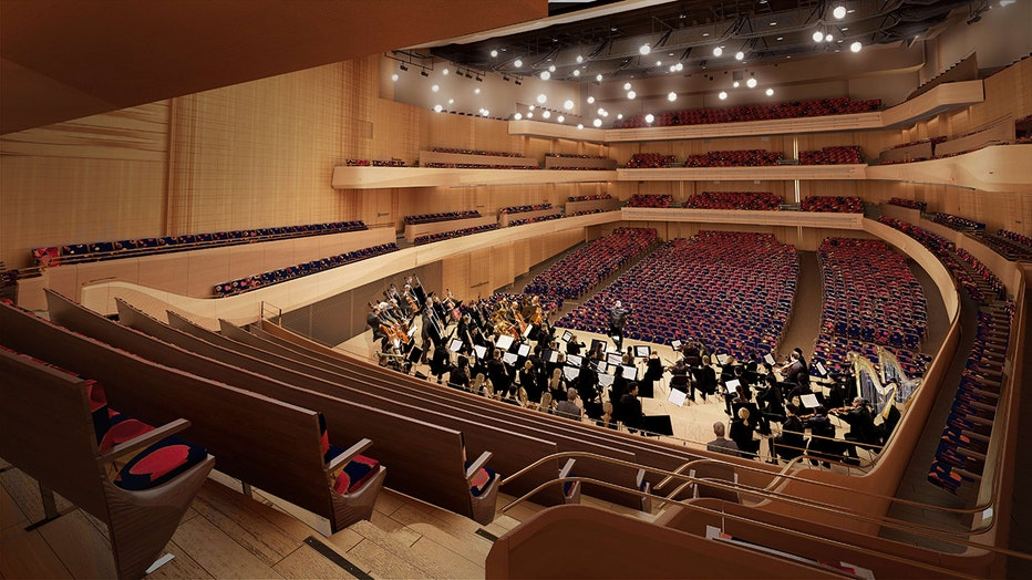 A rendering of a concert hall showing an orchestra on a stage with empty seats