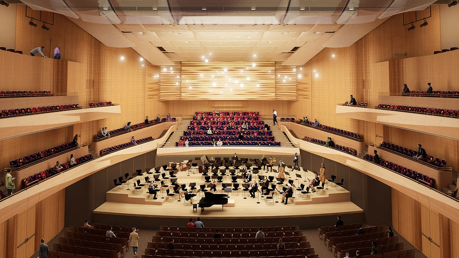 Artist's rendering of interior of a concert hall depicting a few musicians on stage and some spectators in seats or walking in aisles