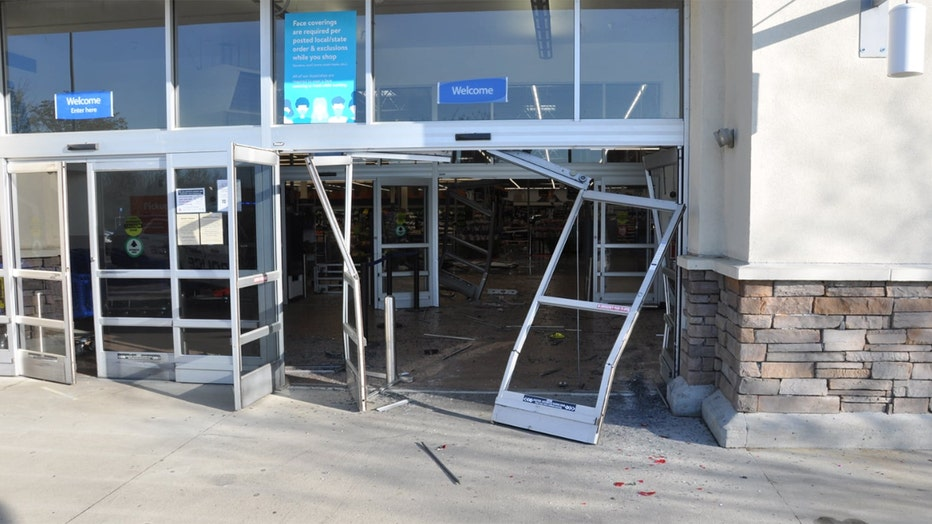 The police department released a photo showing the smashed front door of the Walmart.(Concord Police Dept.)